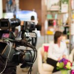 A video camera records an interview