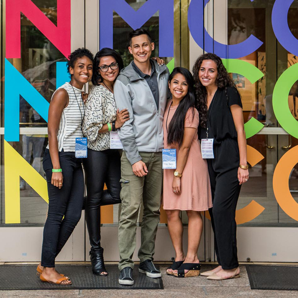 2016 attendees capture memories in front of MCON signage at National Geographic.